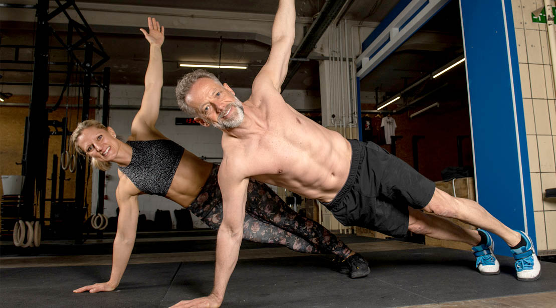 Healthy aging couple working out and exercising with a T Pushup exercise