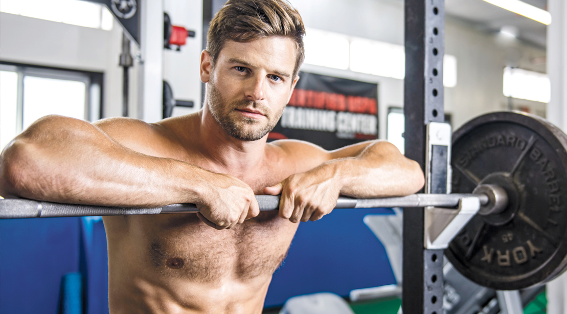 MUSCULAR-Man-leaning-against-barbell