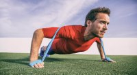 Man-Doing-Banded-Pushup-On-Astroturf for his band workout