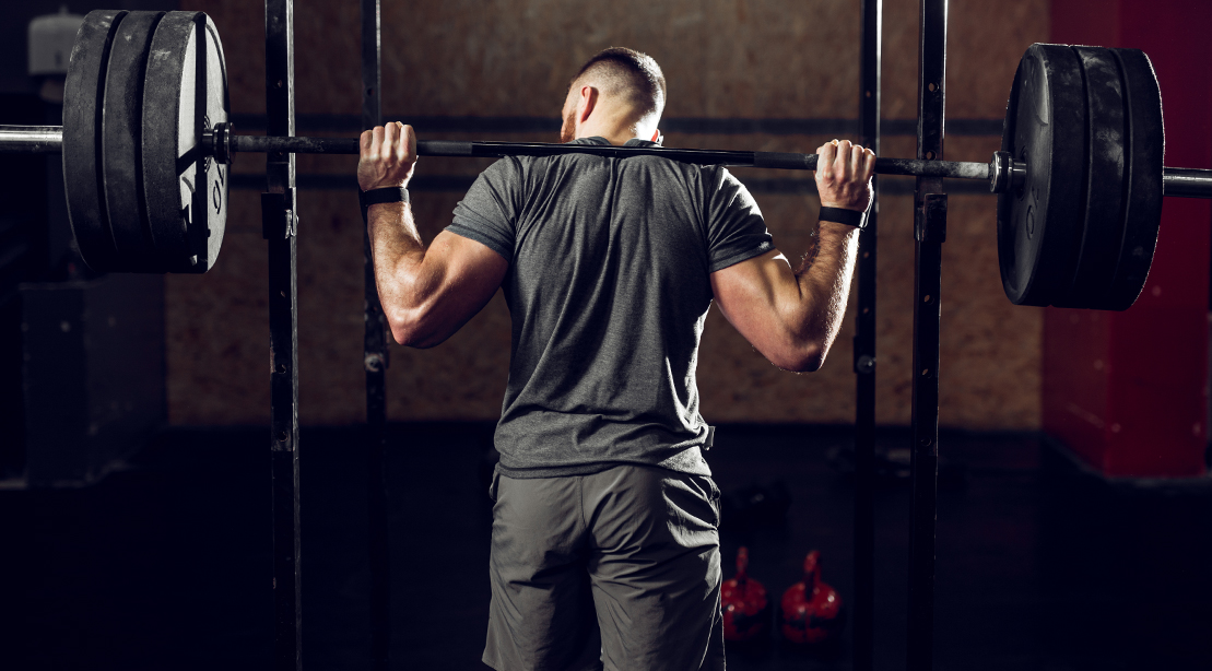 Man-Performing-BEHIND-THE-NECK PRESS