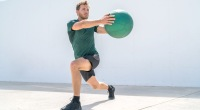 Man-Wearing-Green-Shirt-Doing-Rotational-Lunge-With-Medicine-Ball