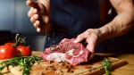 Muscular-Chef-Seasoning-Raw-Meat