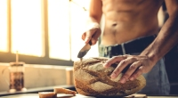 Muscular-Guy-Cutting-Loaf-Bread