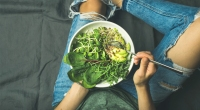Person-Eating-Plate-of-Green-Foods-With-Fork