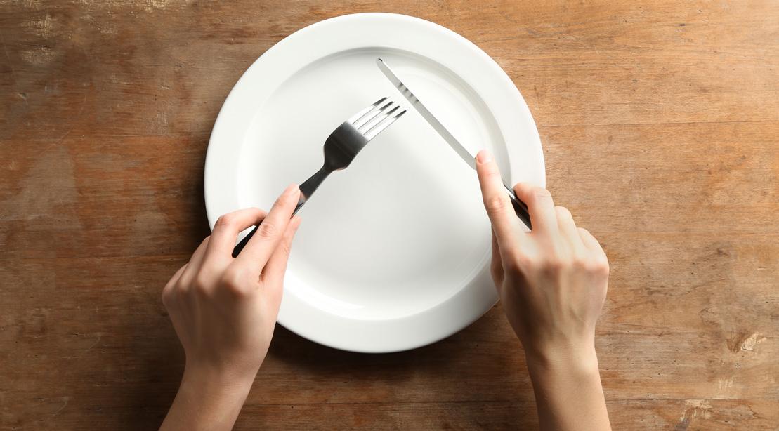 Hands Above an Empty Plate