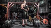 Bodybuilder-Big-Man-Preparing-For-Deadlift-Wrist-Straps-Barbell