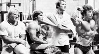 Dave Draper and Arnold Schwarzenegger hanging out with Frank Zane who is posing