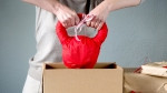 Guy-Pulling-Out-Wrapped-Kettlebell-From-Cardboard-Box