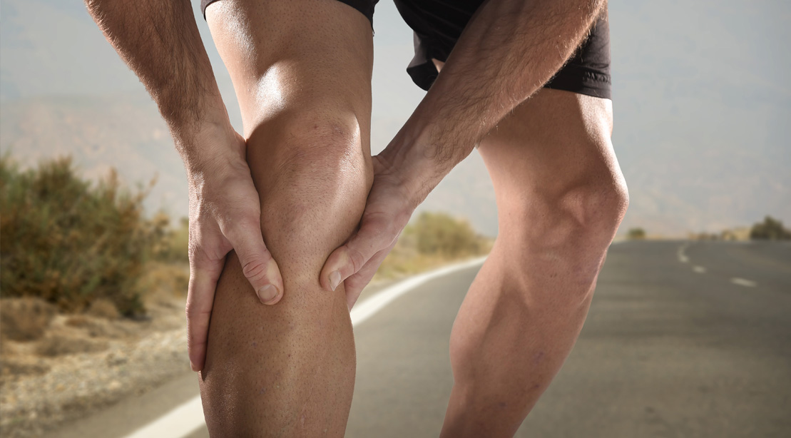 Man-Holding-His-Muscular-Legs-In-Pain