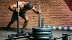 Man-Pushing-Weighted-Sled-Prowler