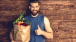 Muscular-Man-Holding-Bag-Of-Groceries