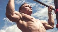 Muscular-Man-Outdoors-Doing-Pullups
