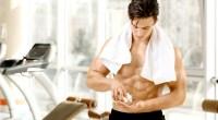 Muscular-Man-Taking-Pills-In-Gym