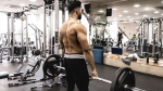 Muscular-Topless-Man-Deadlifting-In-Gym