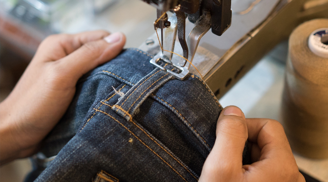Person-Manufacturing-Jeans-Stitching
