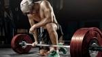 Tired-Topless-Man-Kneeling-Down-On-Floor-Barbell