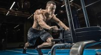 Topless-Muscular-Male-Pushing-Prowler-Sled