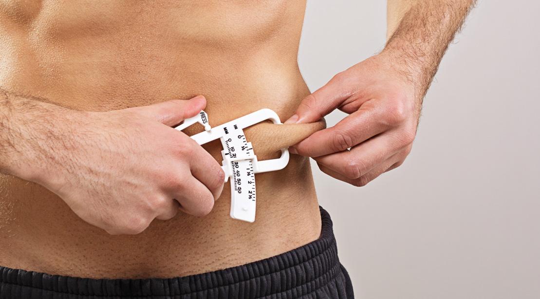 Man Measuring Body Fat With Caliper