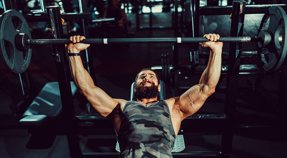 Man Incline Bench Pressing in the Gym