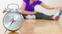 Alarm-Clock-With-Woman-Stretching-Leg-Stretch-Background