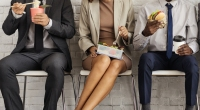 Business-Woman-Between-Business-Men-Eating-Lunch