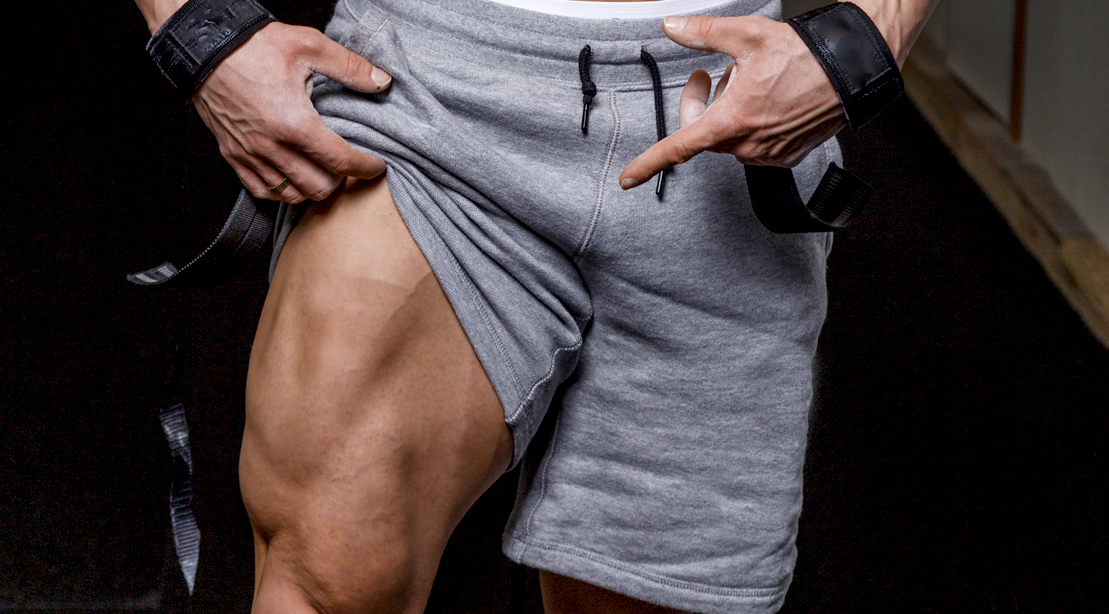 Close-Up-Of-Man-Showing-Off-Quad-Muscle