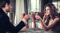 Couple-On-Dinner-Date-Cheers-Wine-Glasses