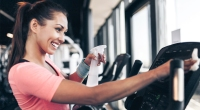 Female-Cleaning-Wiping-Down-Gym-Equipment-Bacteria