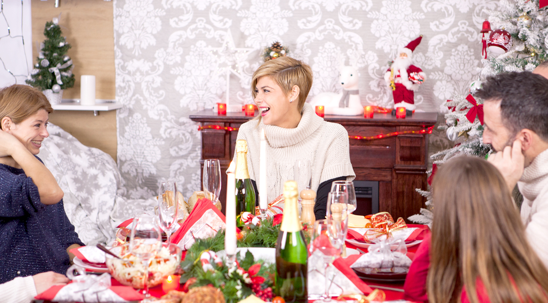Female-Laughing-At-Holiday-Party-Meal