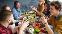Friends-Gathered-Around-Dinner-Table-Meal