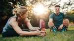 Healthy and Happy Couple Stretching on a Grassy field