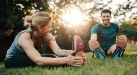 Healthy-Happy-Couple-Stretching-Grass