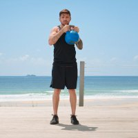 Luke-Zocchi-Doing-Kettlebell-Halo-On-Beach