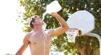 Male-Basketball-Player-Drinking-Gallon-Water