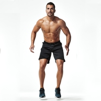 Male-Performing-Jump-Squat-Tap-Position-Two