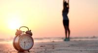 Morning-Alarm-Clock-On-Beach-Girl-Stretching-Sunrise