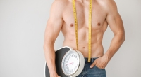 Muscular-Male-Holding-Scale-Measuring-Tape-Around-Neck