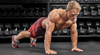 Muscular-Male-Topless-Performing-Pushup-With-Knee-Tuck-Position-One