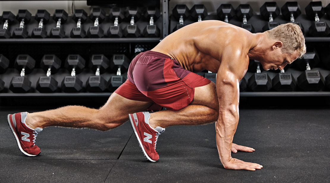 Muscular-Male-Topless-Performing-Pushup-With-Knee-Tuck-Position-Two