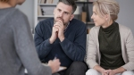 Older-Couple-In-Therapy-Session-Man-Listening