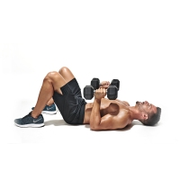 Topless-Muscular-Male-Performing-Lying-Dumbbell-Chest-Press-Position-One