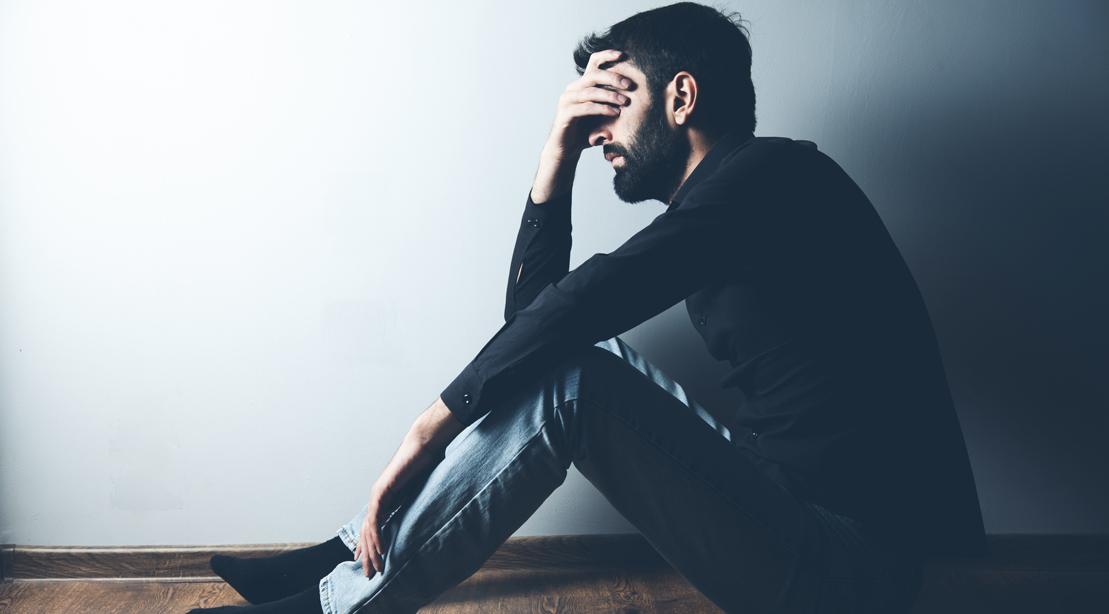 Sad Man Sitting in a Dark Room
