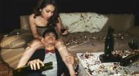 Asian-Couple-Celebrating-Drinking-Wine-Confetti