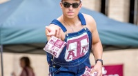 College-Texas-AM-Student-Wearing-Overalls-Playing-Cornhole-Throwing-Bean-Bag