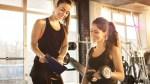 Female-Fitness-Trainer-Showing-Progress-To-Beginner-Exercise