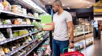 Man-Shopping-Grocery-Store-Reading-Nutrition-Label