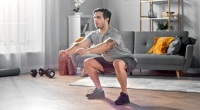 Man-Squatting-at-Home-Living-Room
