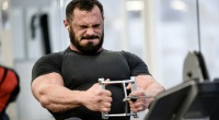 Muscular-Man-With-Beard-Straining-To-Lift-Weights
