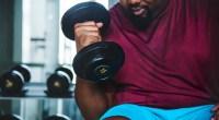 Overweight-Man-Lifting-Lightweight-Dumbbell