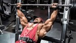 Bodybuilder Roelly Winklar working out his upper body with an incline barbell bench press